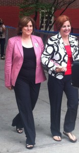 Christine Quinn holds hands with her wife on during the Democratic Primary. Credit: Deanne Stewart