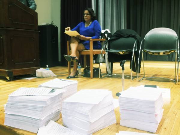 Community Board 9 District Manager Pearl Miles with  petition letters the Movement to Protect the People collected for Mayor Bill de Blasio. (Marco Poggio Photo).