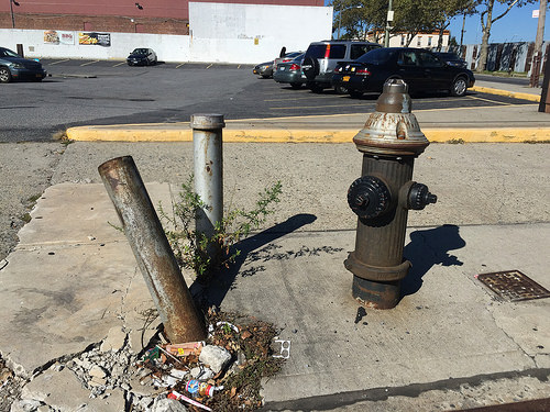 A damaged fire hydrant off the corner of Atlantic Avenue and Logan Street, a dangerous Brooklyn intersection.